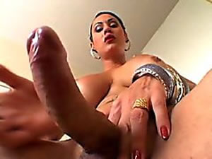Busty shemale whore jerking giant cock